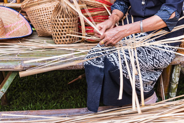 Weaving bamboo basket.