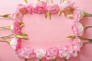 Fresh flowers frame on pink background