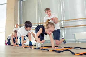 Happy sporty children in gym.