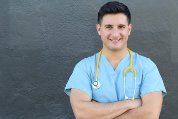 Stock image of medical intern standing with arms crossed over gray background