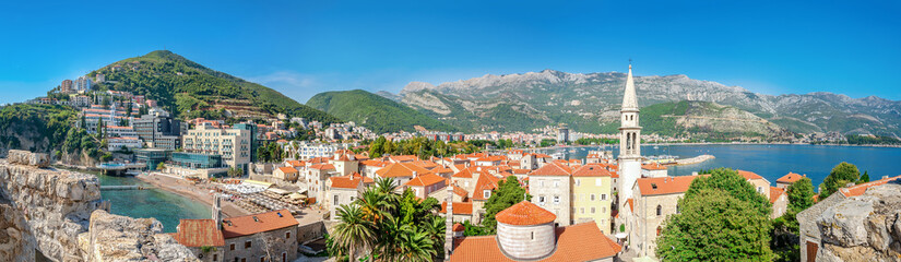 Panoramic view of Budva, Montenegro from citadel in old town. Copy space in clear sky.