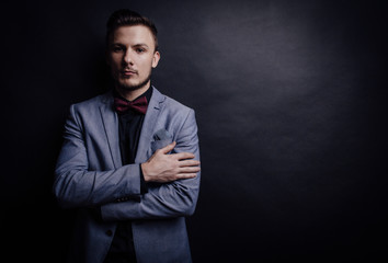 Confident man looking forward on dark background