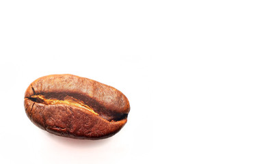 Macro of roasted coffee beans isolated on white background with copy space