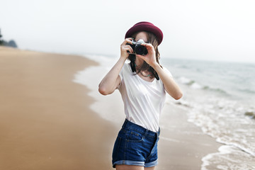 Woman Travel Photographing Beach Concept