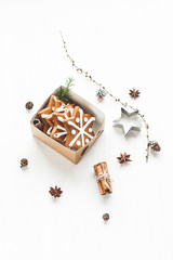 Christmas composition. Gift, larch branches, cinnamon sticks, an
