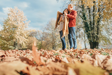 Couple in love have a romantic time in autumn park