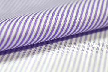 close up roll light purple and white fabric of shirt
