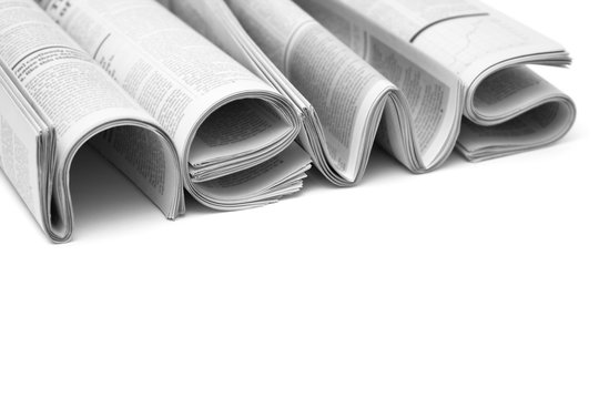 Folded modern newspapers. Concept of business news and print media
