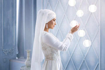 beautiful bride in white traditional muslim dress