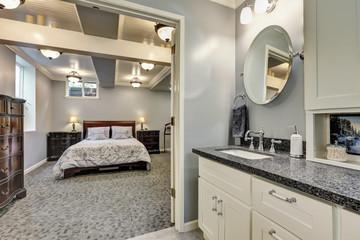 Basement bathroom interior in gray and white tones