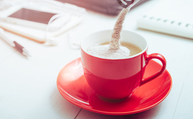 instant coffee mixed 3 in 1 is pouring into a coffee cup.