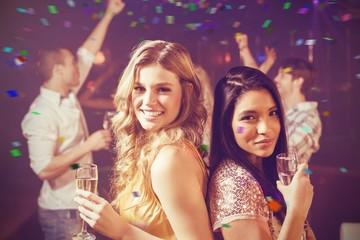 Composite image of happy friends dancing