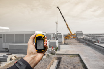 finding the right position inside a construction site via gps (blurred background)