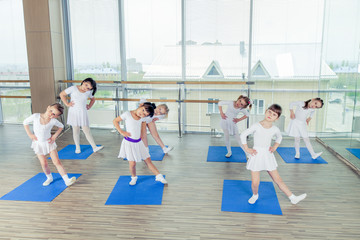 Girls doing gymnastic exercises or exercising in fitness class