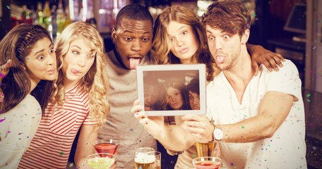 Composite image of friends taking selfie with tablet