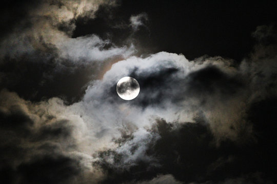 Full Hunter's Moon with clouds, eerie or spooky full moon for Halloween or fall