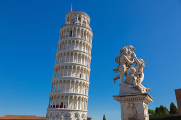 World famous Leaning Tower of Pisa and status of cherubs winged angels in Pisa, Italy. Pisa Tower (Torre pendente di Pisa) is a freestanding bell tower campanile of cathedral.