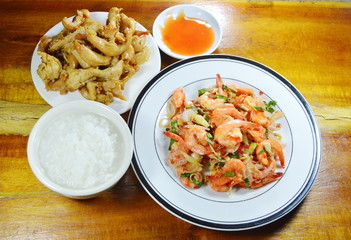boiled rice eat with spicy shrimp salad and fried chicken