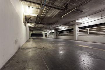 Parking garage interior, neon lights in industrial building.