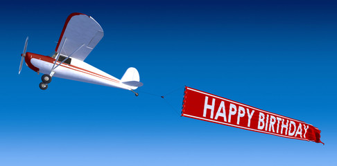 Happy Birthday on airplane banner