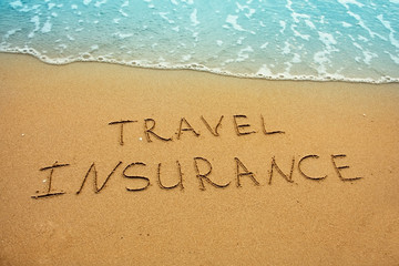 Travel insurance, inscription on sand concept