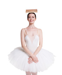 Ballerina training ballet posture isolated on white background