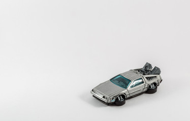 flying, fantastic silver car on a white background
