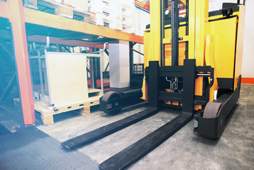 Shelves, racks and forklift  with pallets in distribution wareho