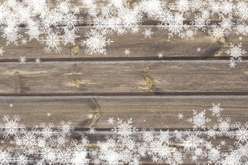 snowflakes on the wooden background