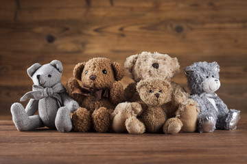 Teddy bears on vintage wooden background