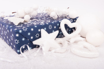 Christmas presents on white snow close-up