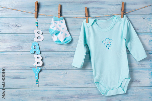 5a9612502 Baby clothes and word baby on a clothesline