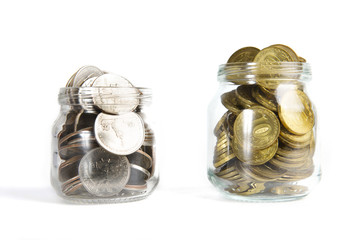 Glass bank for tips with money isolated on white.