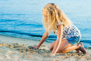 Girl on the sand near the water