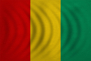 Flag of Guinea wavy, real detailed fabric texture