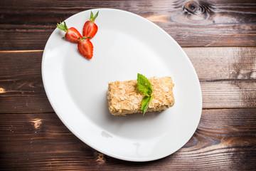 Napoleon cake on white plate