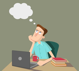 Man is thinking and sitting at the table with laptop and books.