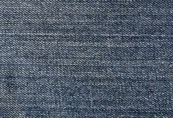 Blue jeans textile surface.