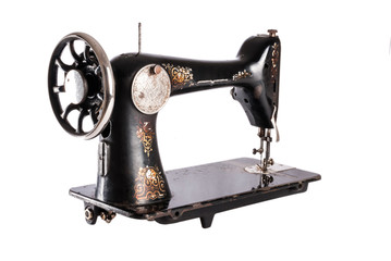 The old sewing machine on a white background