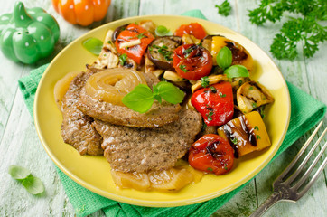 Beef steak and Grilled vegetables on the plate