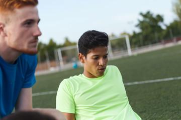 two soccer players having a break