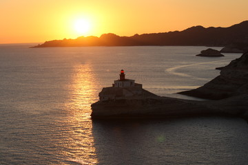 france, corsica. bonifacio lighthouse at sunset