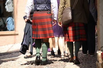 Malcesine. Garda lake. Men wearing kilt, walking in the street