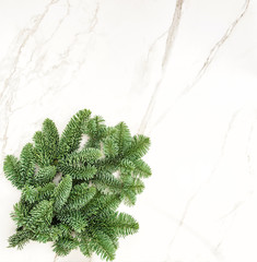 Pine branches marble stone texture Christmas background