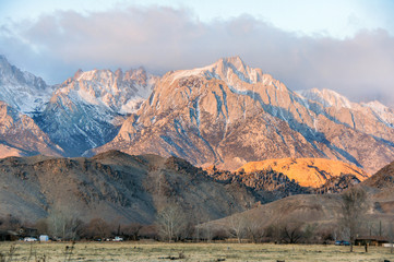 Sunrise on Mt. Whitney and the Sierra Nevada Mountains. Long Pine, California, USA. Dramatic morning sun lights on the Sierra Nevada Mountains in California.