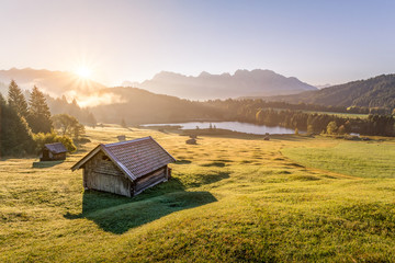 View over Geroldsee with wooden hut and Karwendel mountains at morning, Bavaria, Germany Wall mural
