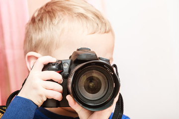 Little boy take photo with camera.