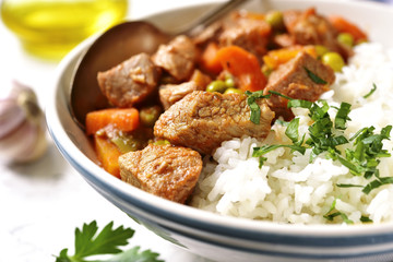 Veal stew served with rice.Vintage style.