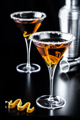 Classy Orange Citrus Martinis on black Background