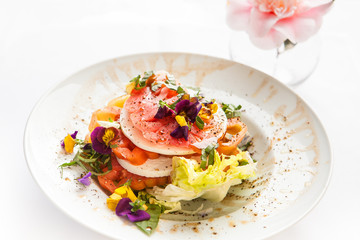 heirloom tomato salad with johnny jump up flowerrs